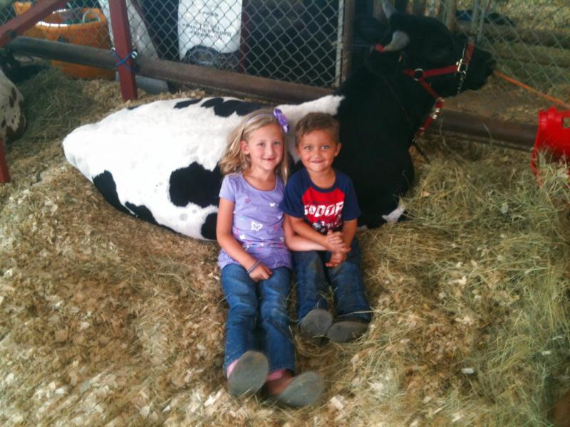 Avery and JP taking a short break at the fair
