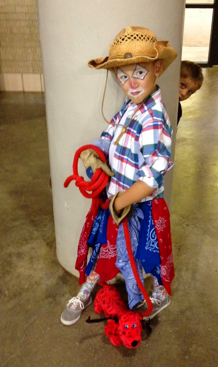 "Rusty the Rodeo Clown and her longhorn ""Fido"""