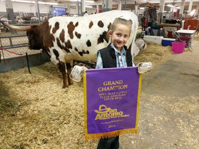 Avery and her Buckles for Grand Champion and Junior Showmanship